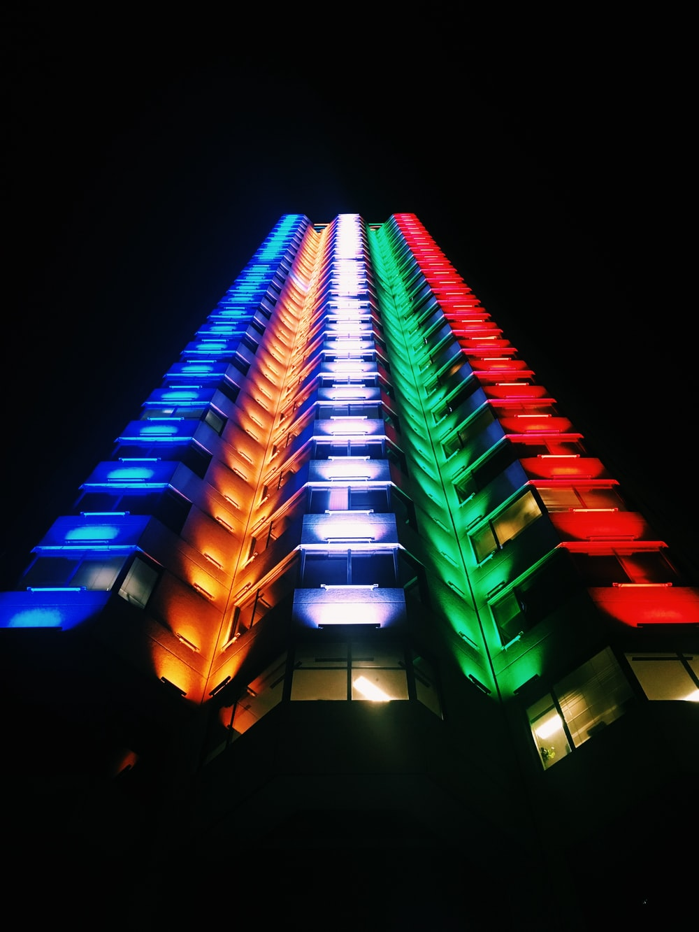low-angle photography of multicolored high-rise building