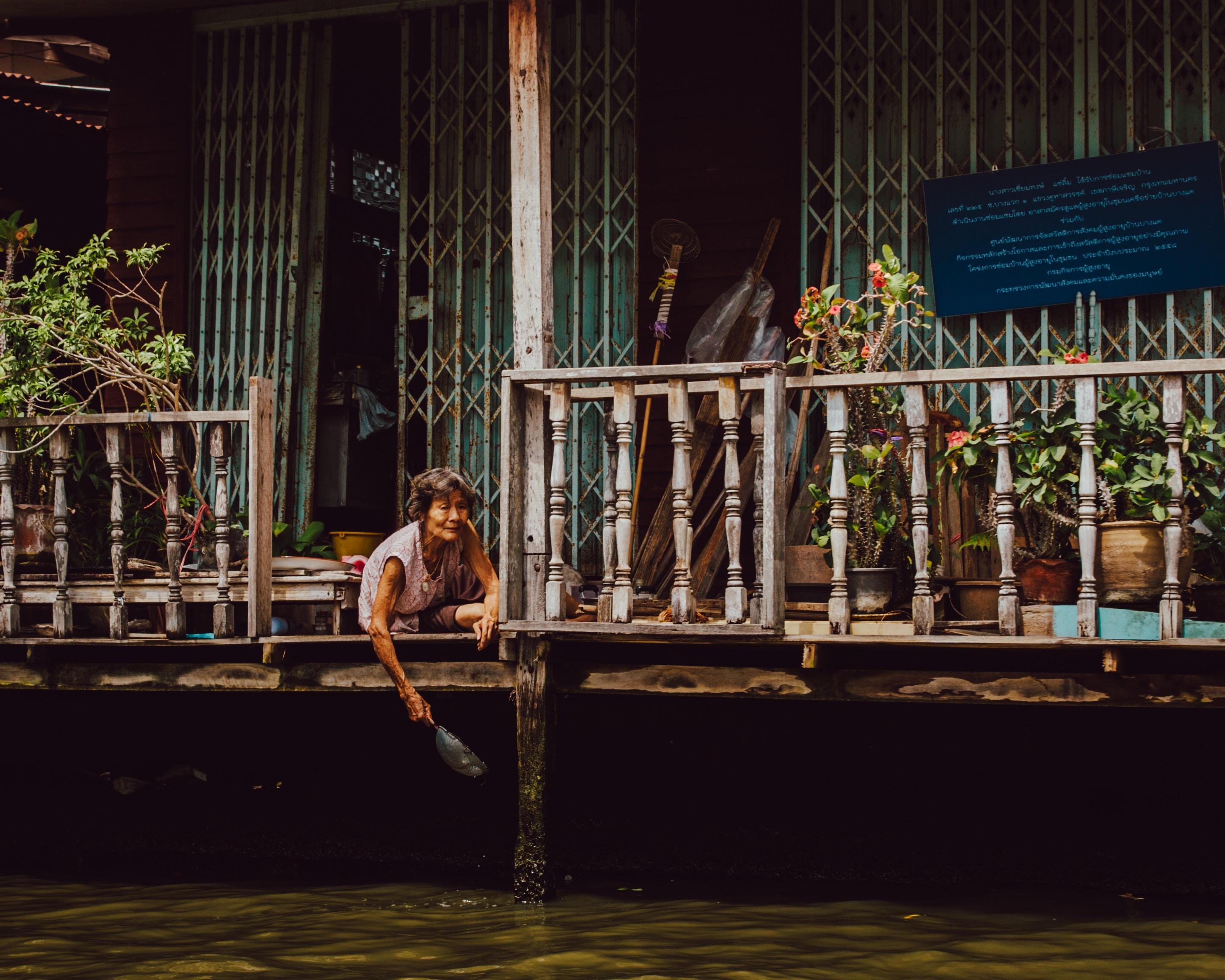woman sitting on floor beside balusters