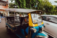 blue and yellow electric rickshaw