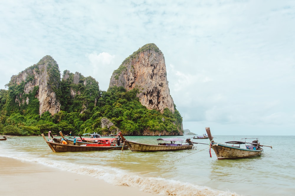 boats docked on seashore during daytime