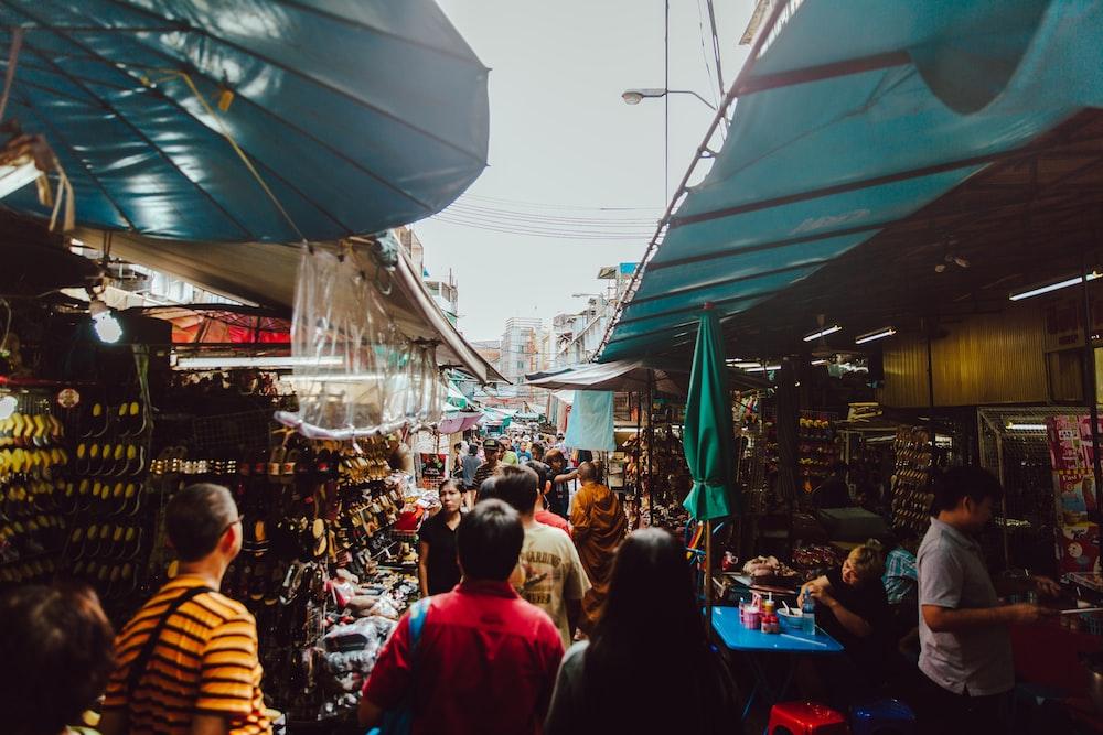 people walking inside food market