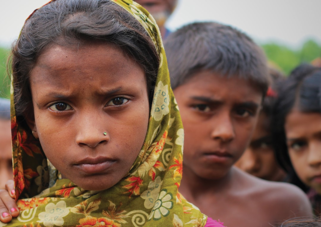 While filming a climate change documentary called Thirty Million for the United Nations, I was blown away by the beauty of the Bangladeshi people — both in their character and appearance. The people we met were hospitable, pragmatic, and had an incredible strength in dealing with the threat climate change poses to their fragile land. Bangladesh faces losing 18% of its land, displacing thirty million people, with one metre sea-level rise. To me, the expression on this coastal girl's face captures the seriousness of the predicament she and her people are in.