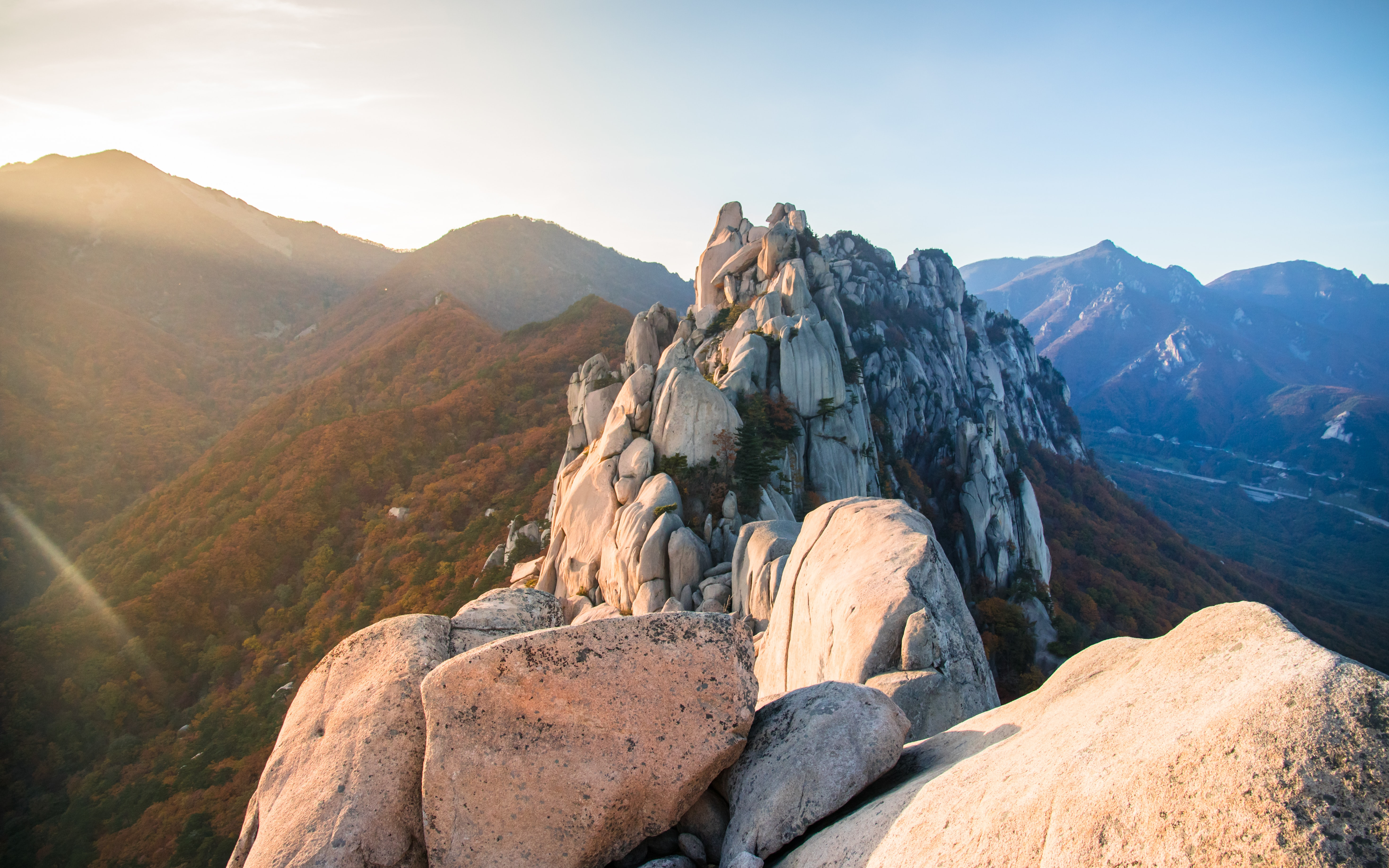 selective focus photography of rock formation near mountain range