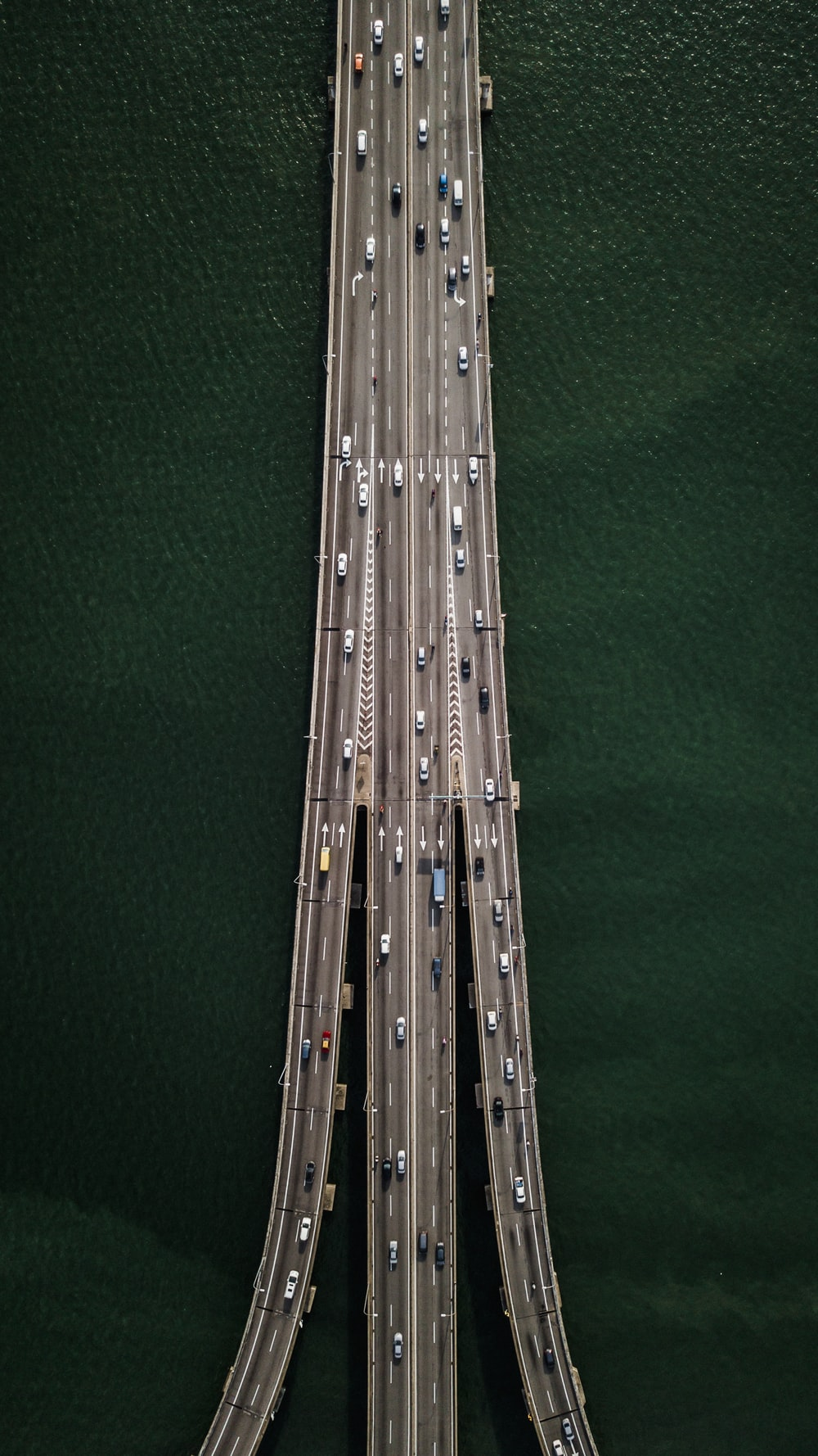 aerial view of bridge with cars crossing