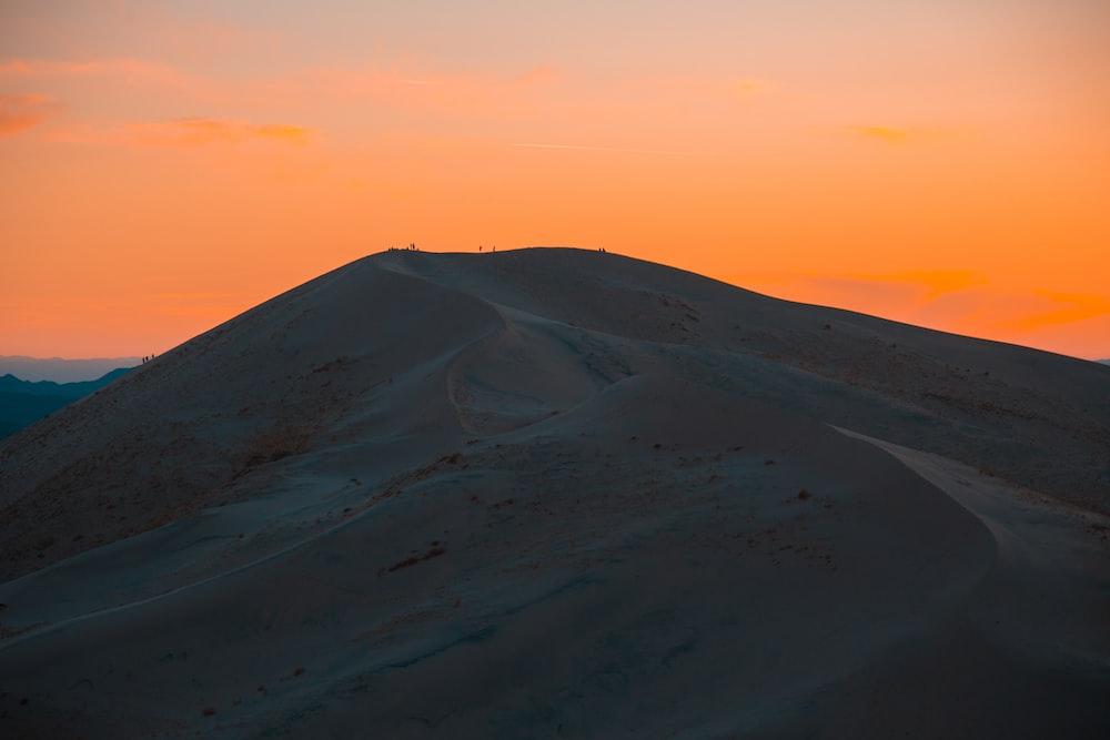 landscape photography of sand dune