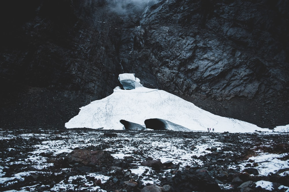 landscape photo of ice near gray cliff