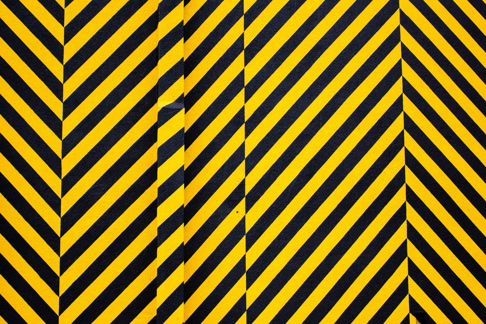 yellow and black striped textile