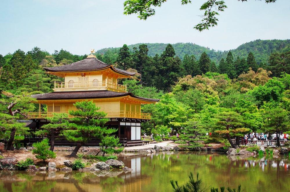 beige house near beside body of water