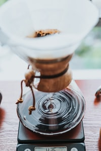 selective focus photography of coffee funnel