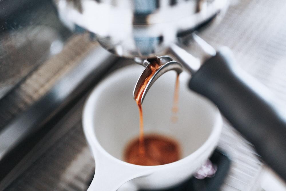 closeup photo of white teacup