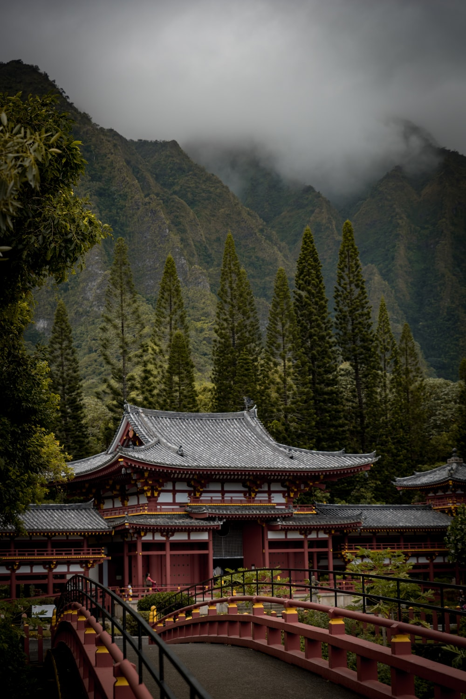 temple with bridge near mountain range