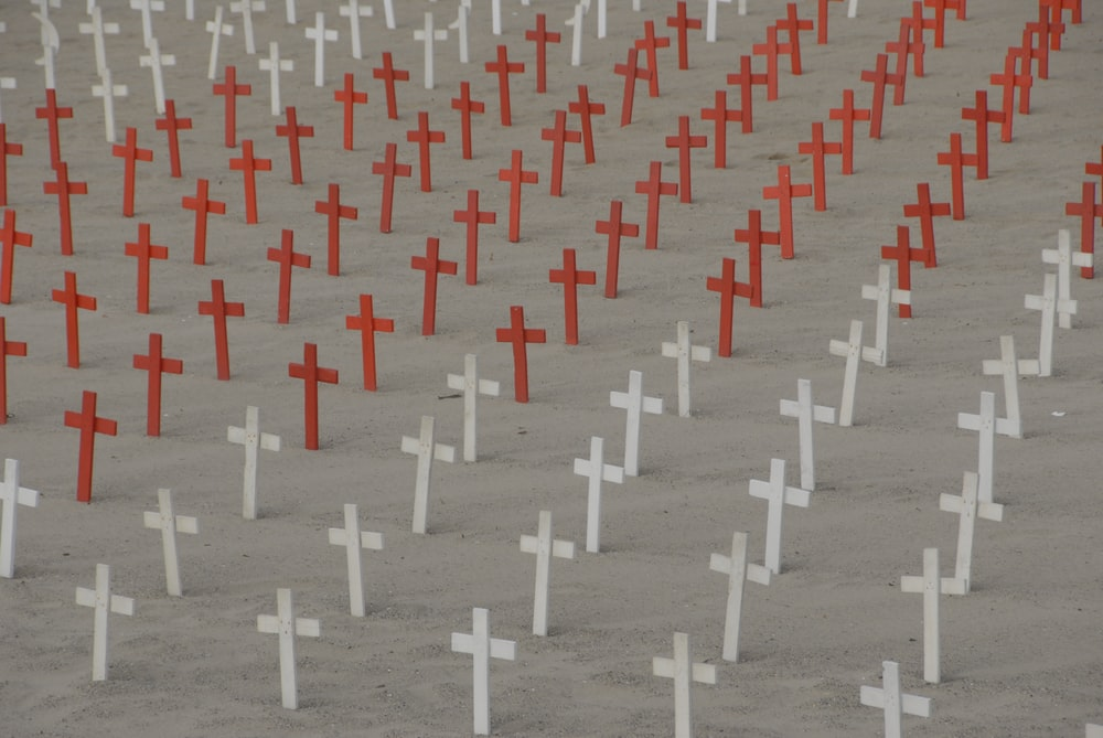 white and red cross cemetery field