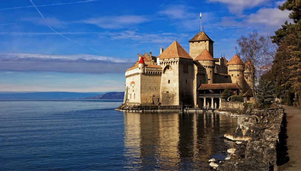 castle by the sea under blue sky