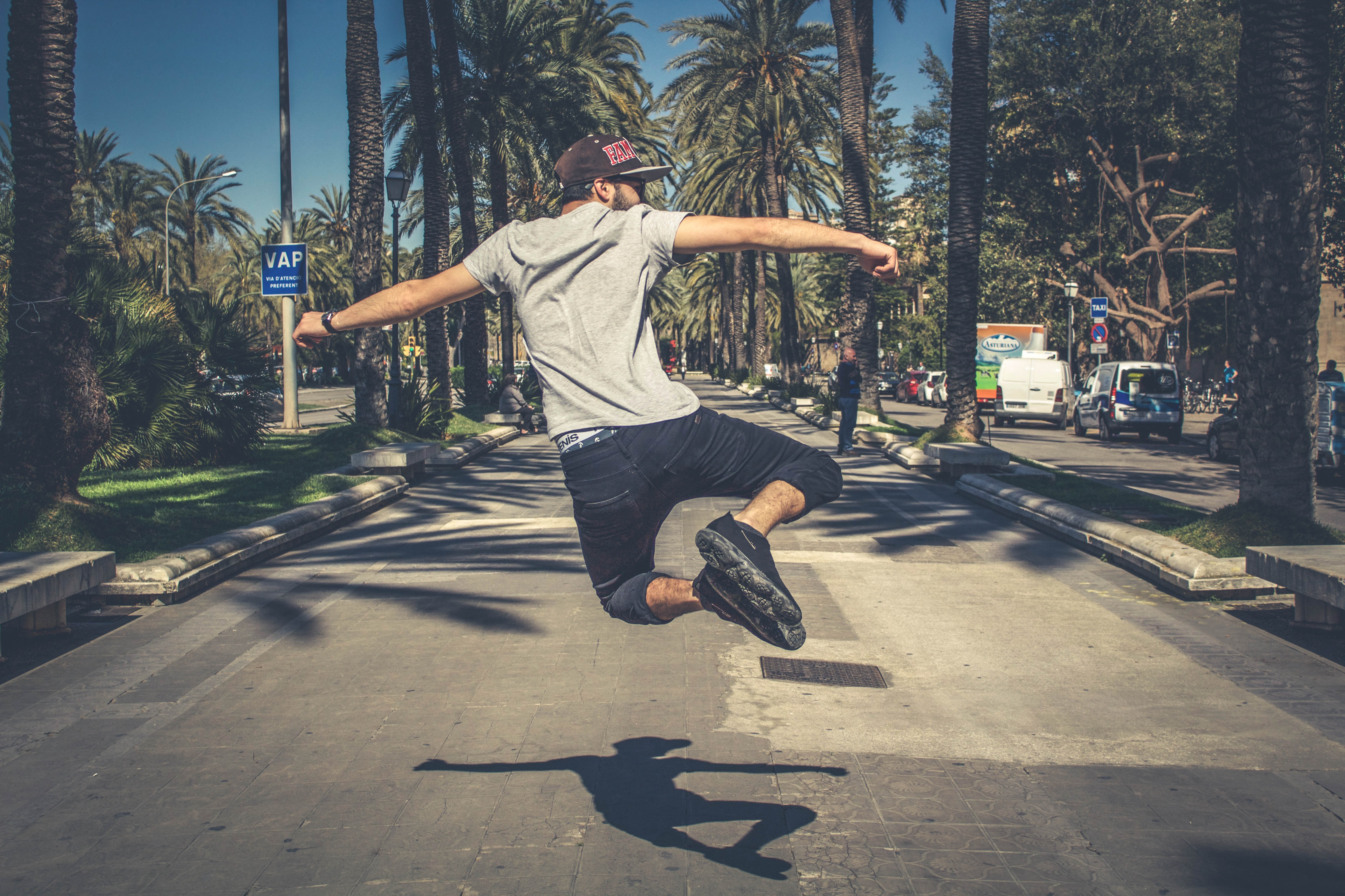 man jumping in the middle of road