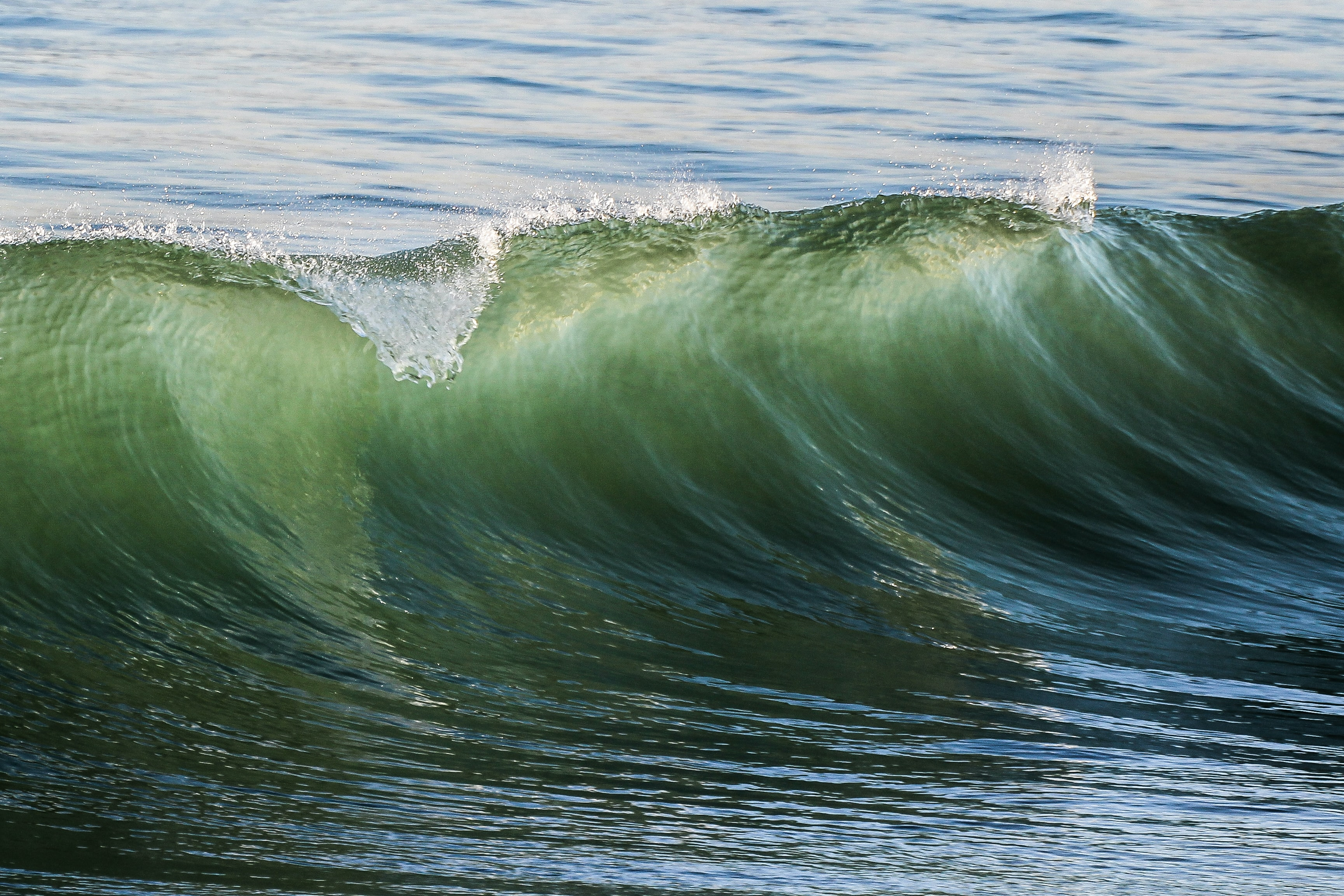 selective focus photography sea wave