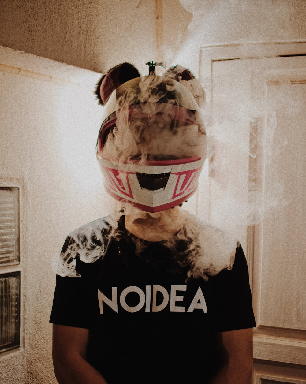 person wearing helmet with smoke