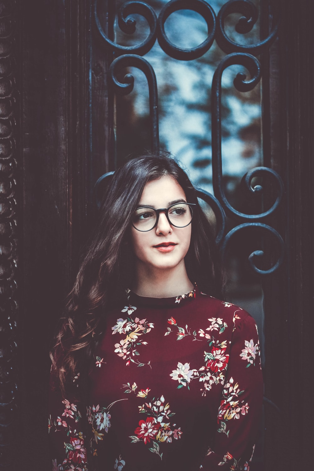 woman with eyeglasses and red dress