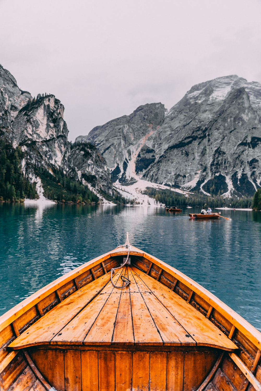 people in brown wooden boat