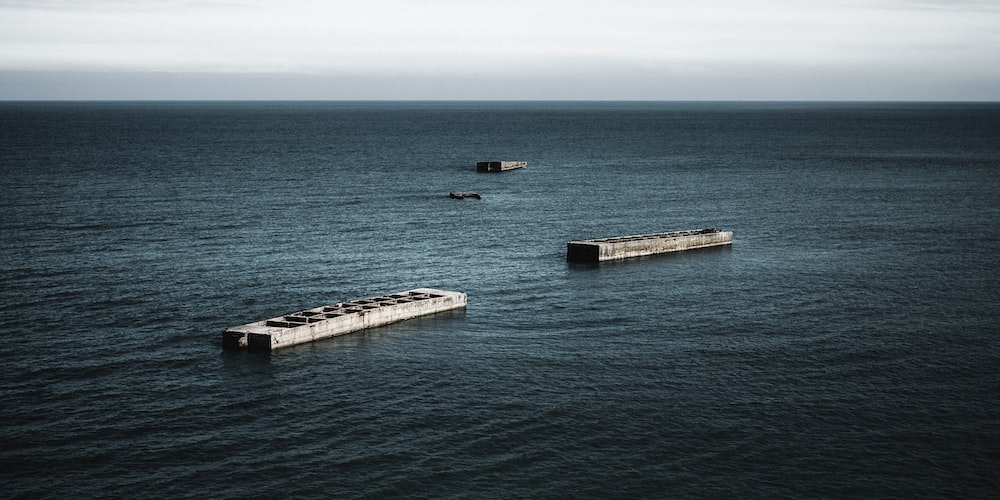 aerial photo of trailers on body of water