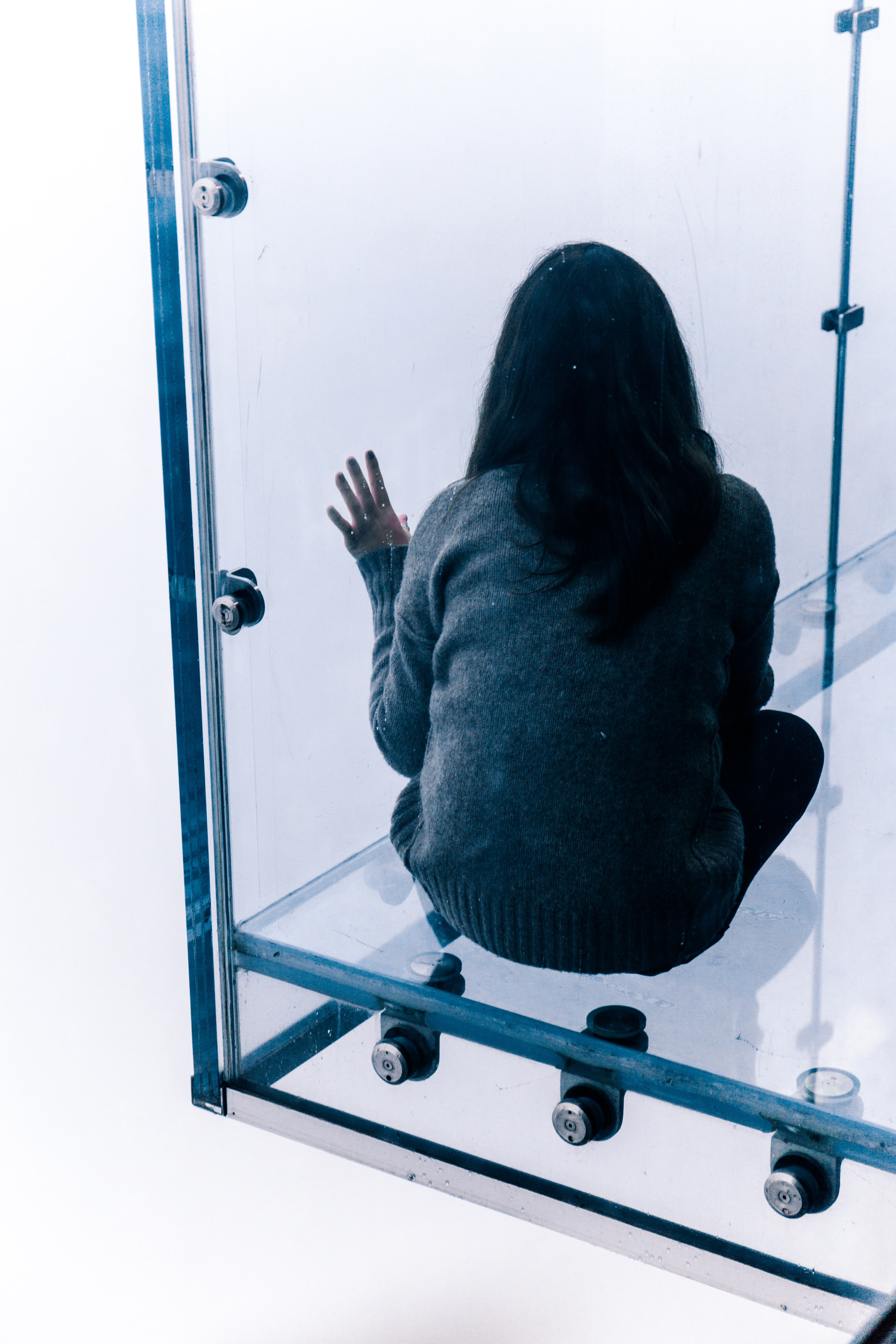 person sitting on glass