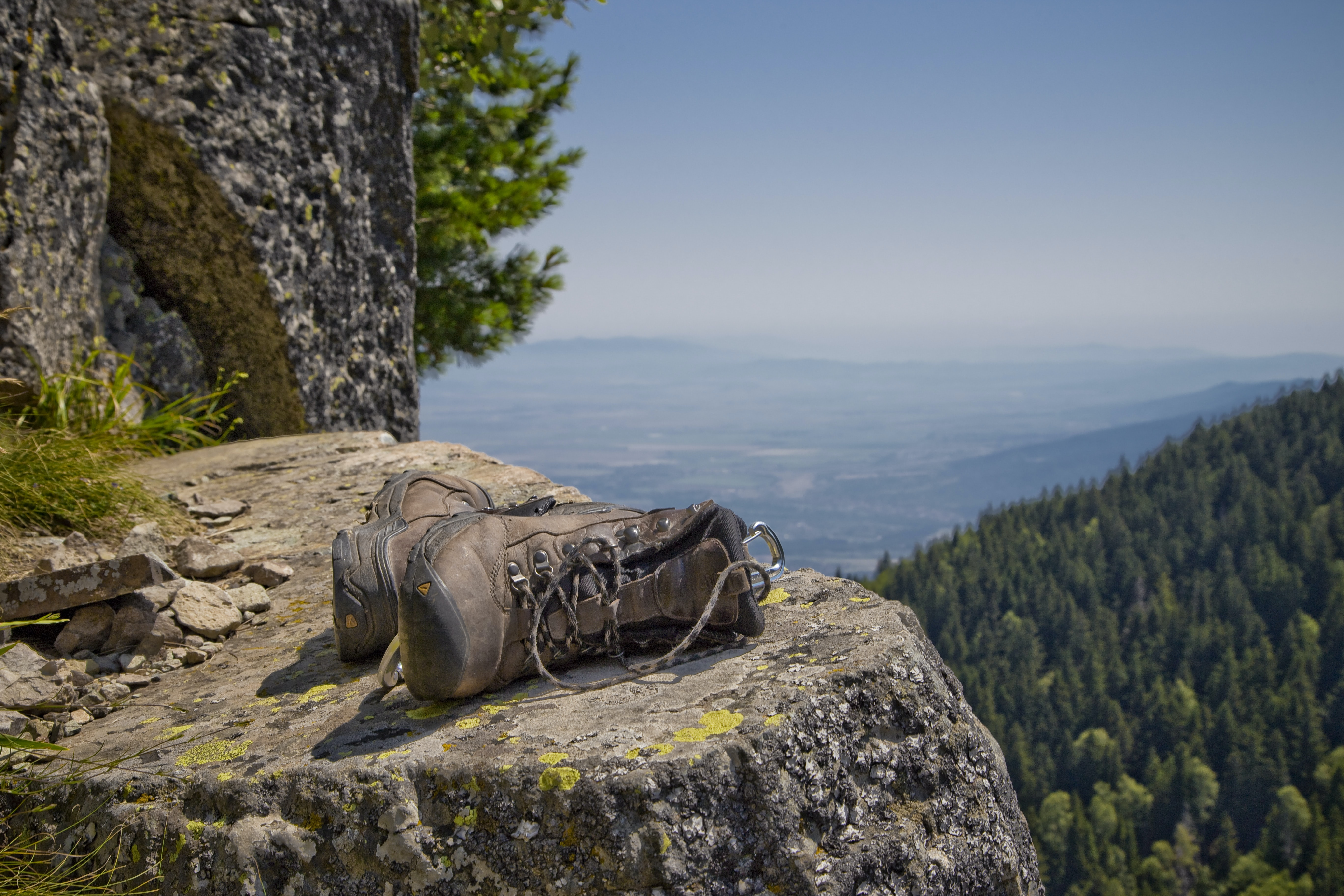 pair of brown leather boots on gray cliff