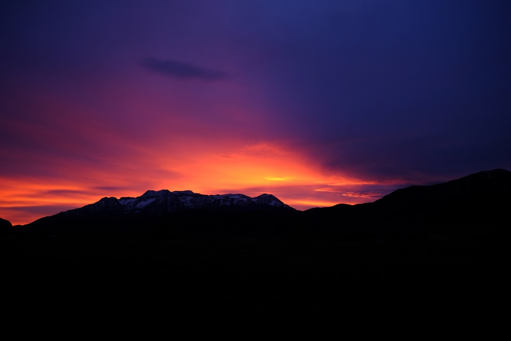 silhouette of mountain under sunset
