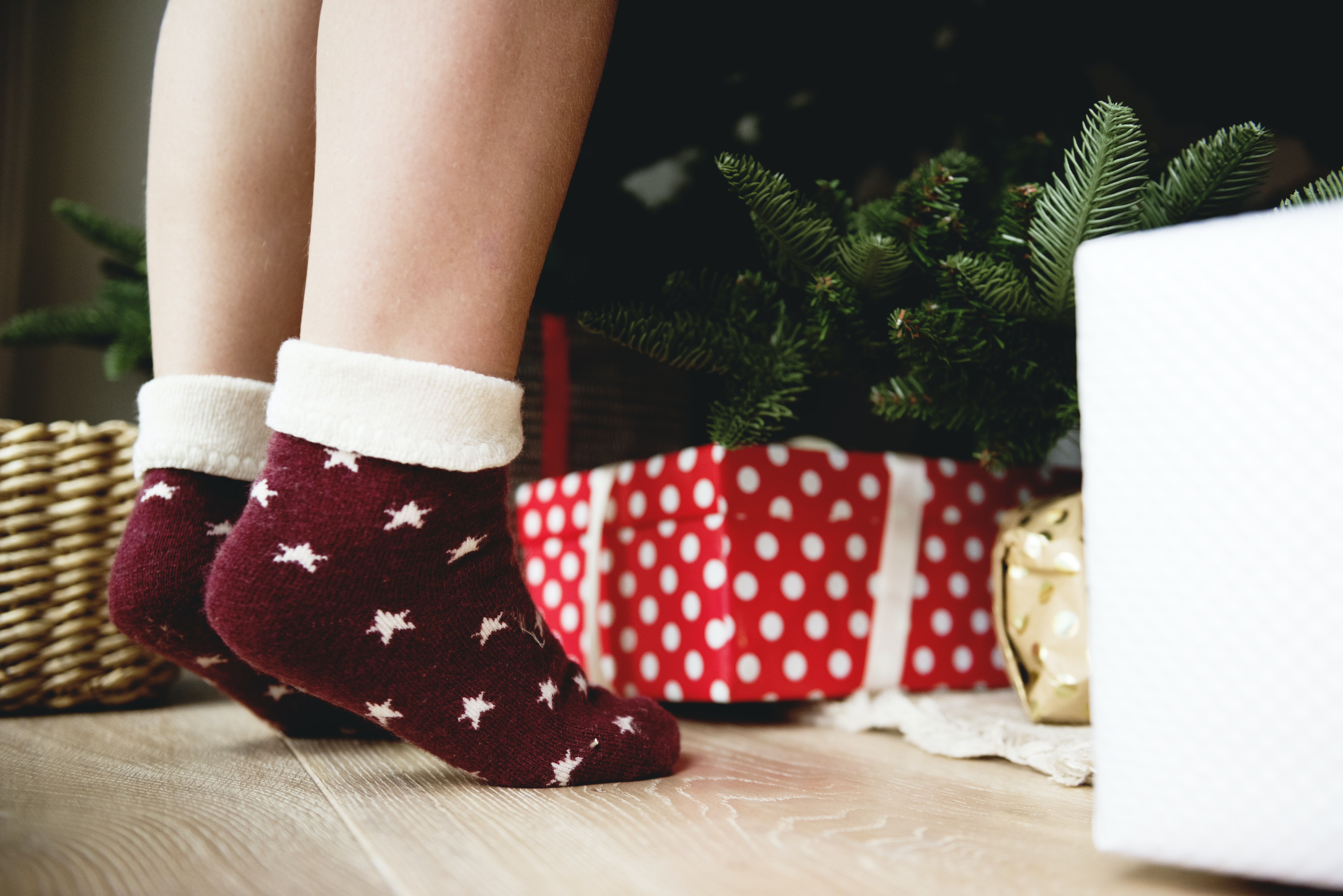 person wearing red-and-white star print socks