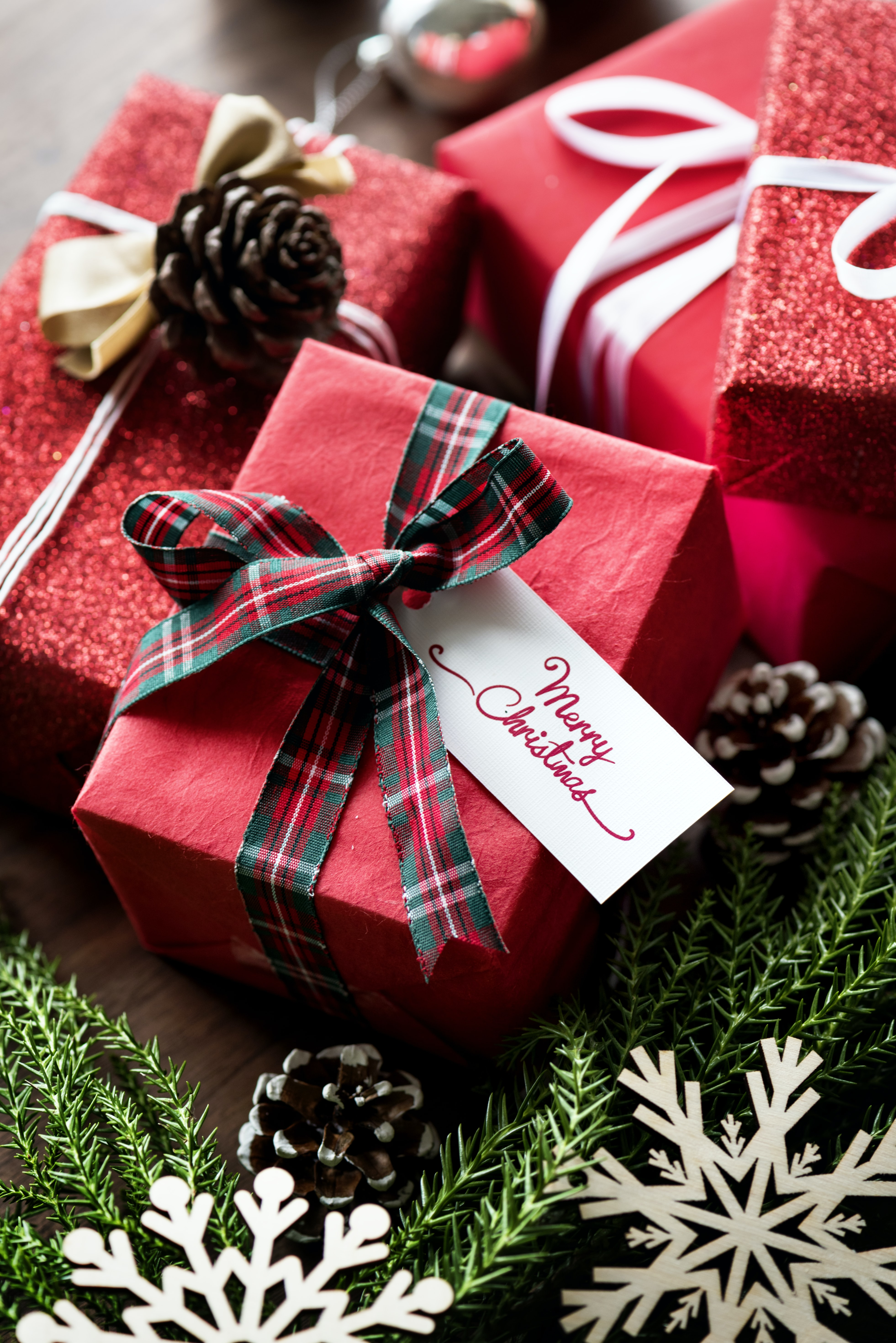 three red Christmas gift boxes