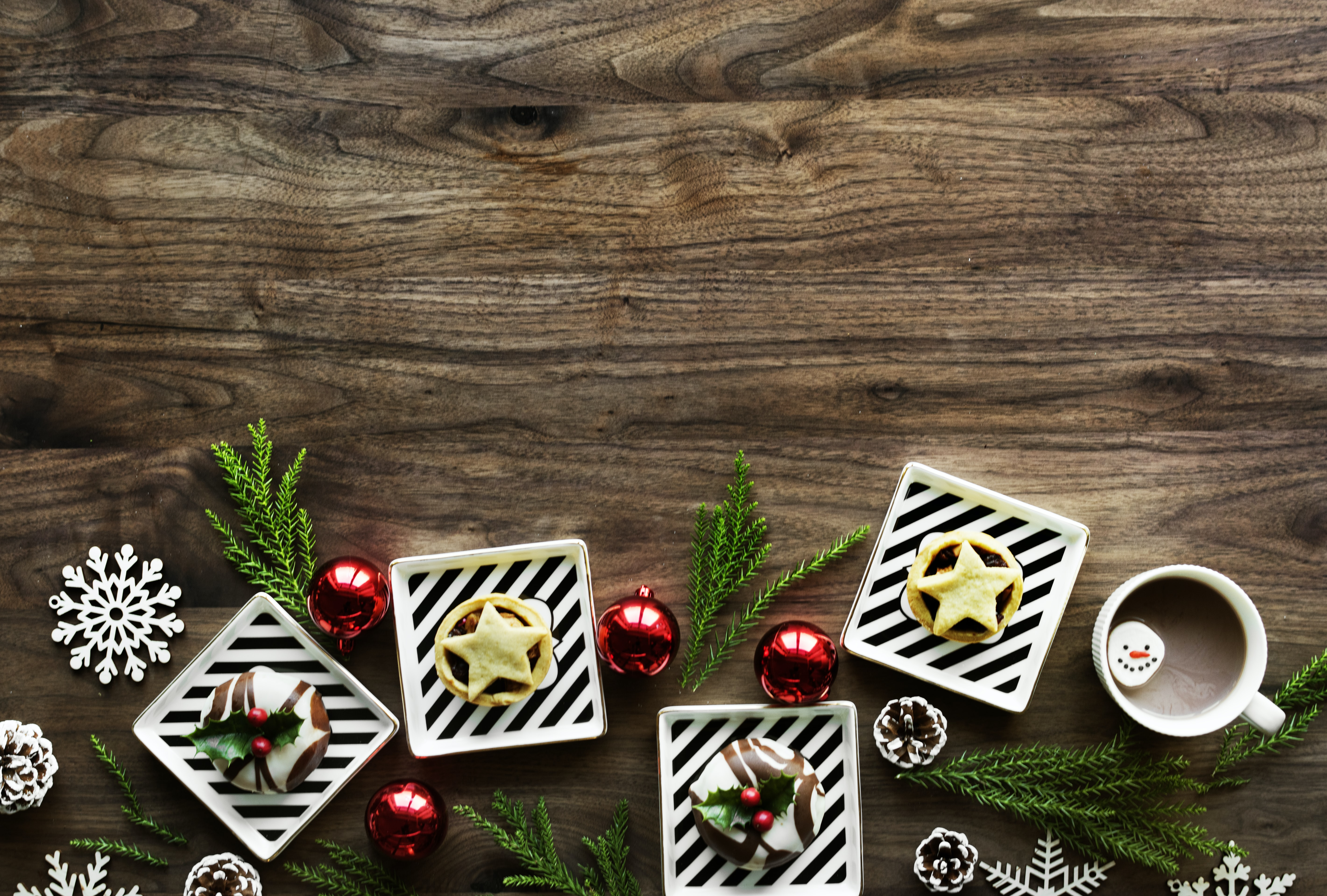 assorted Christmas decors with pastry on top of brown wooden surface