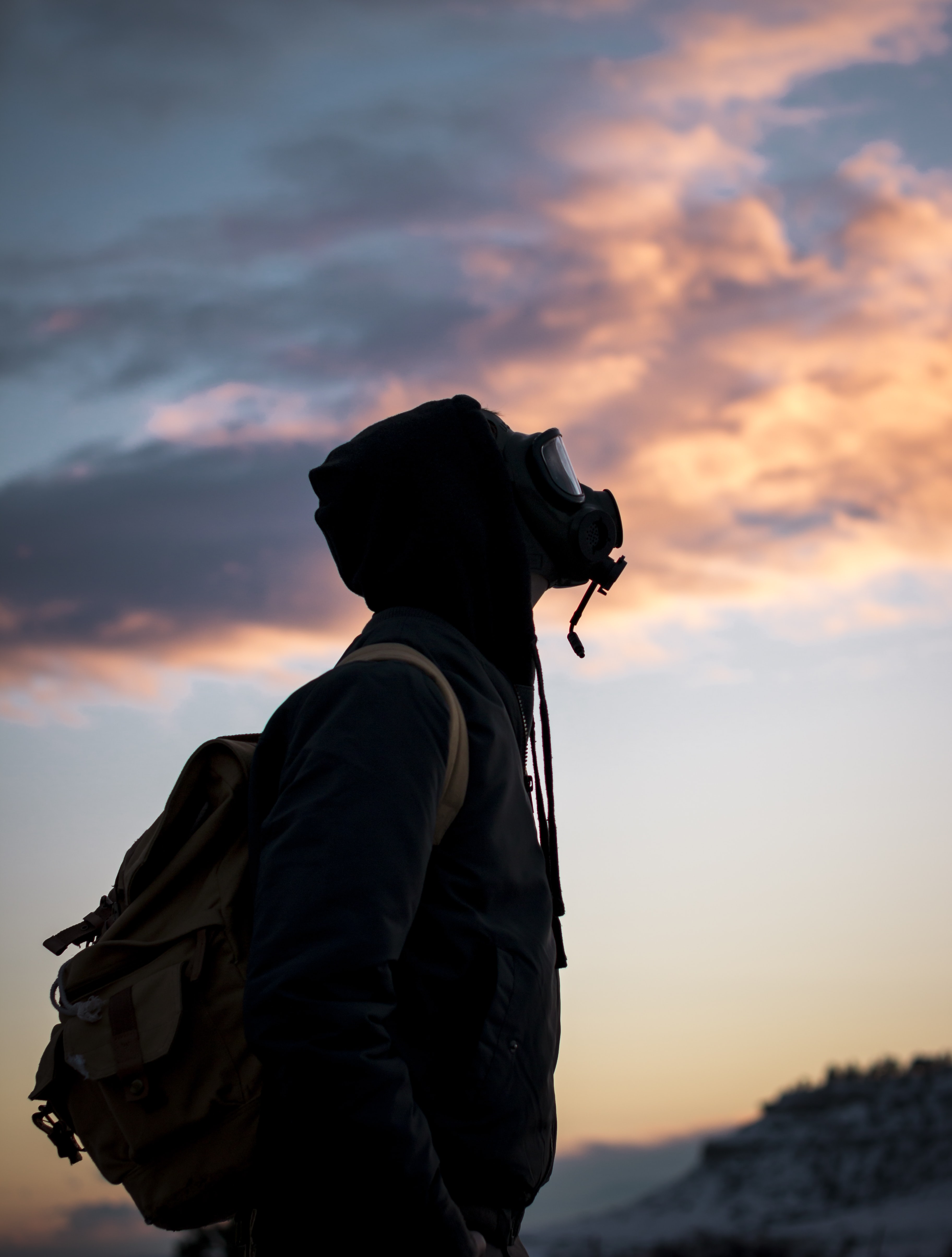 person wearing gas mask while looking up