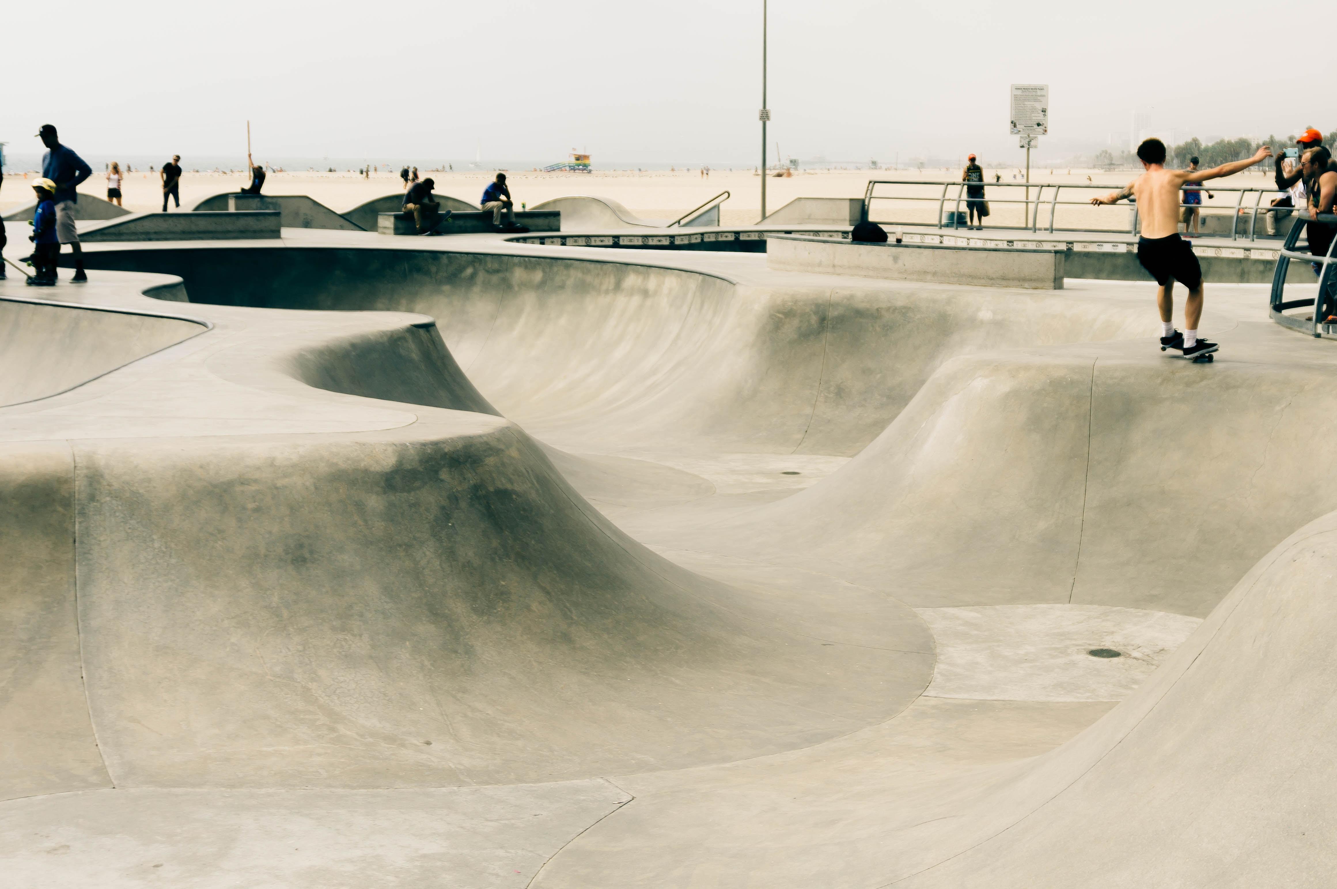 men riding skateboard at daytime