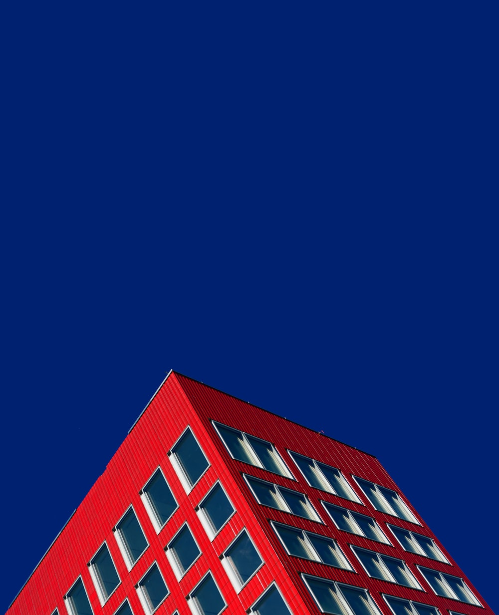 worm's eyeview of red building