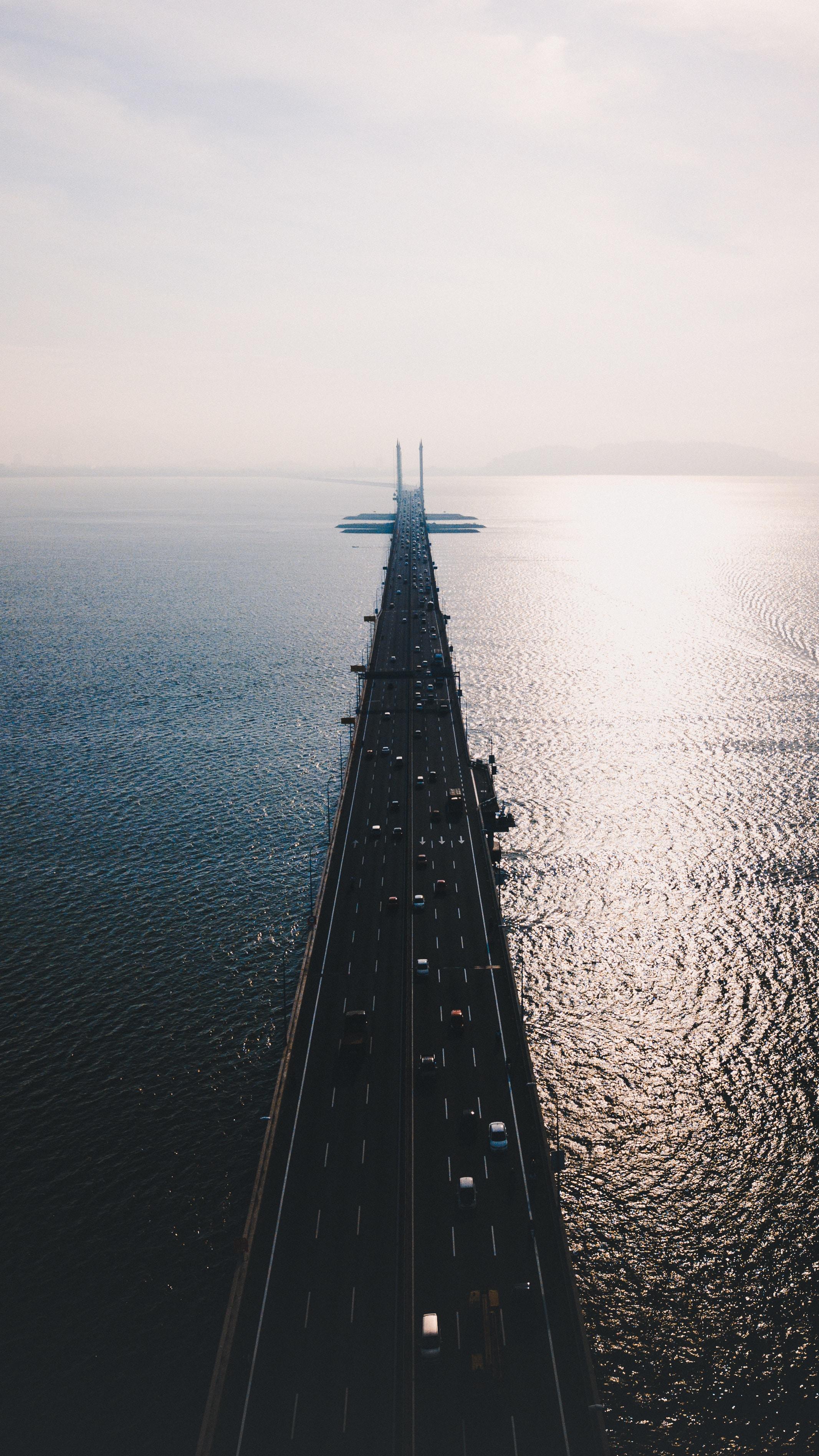 bridge on body of water during daytime