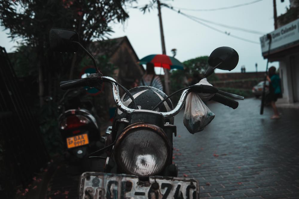 black touring motorcycle on asphalt road during daytime