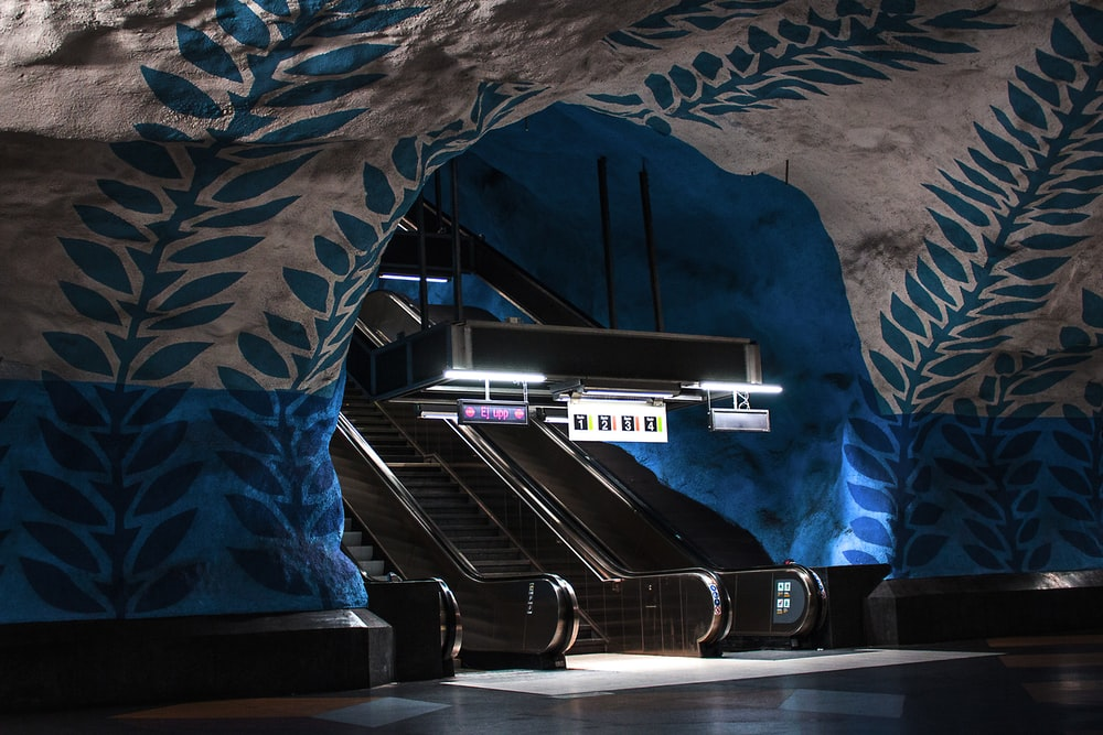 brown escalators with black bar lamp