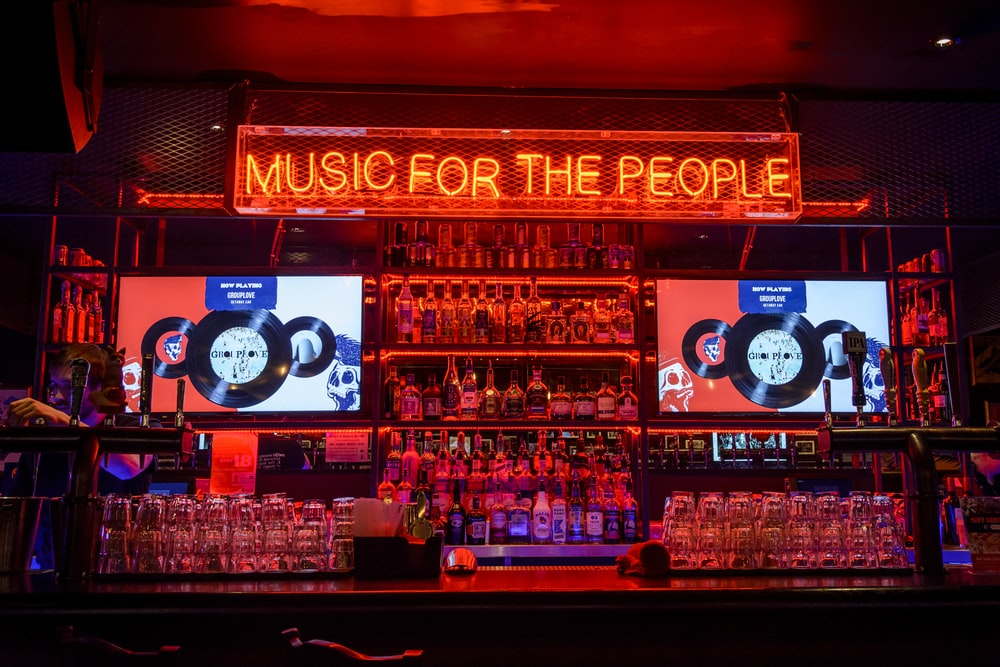 red music of the people neon-light signage