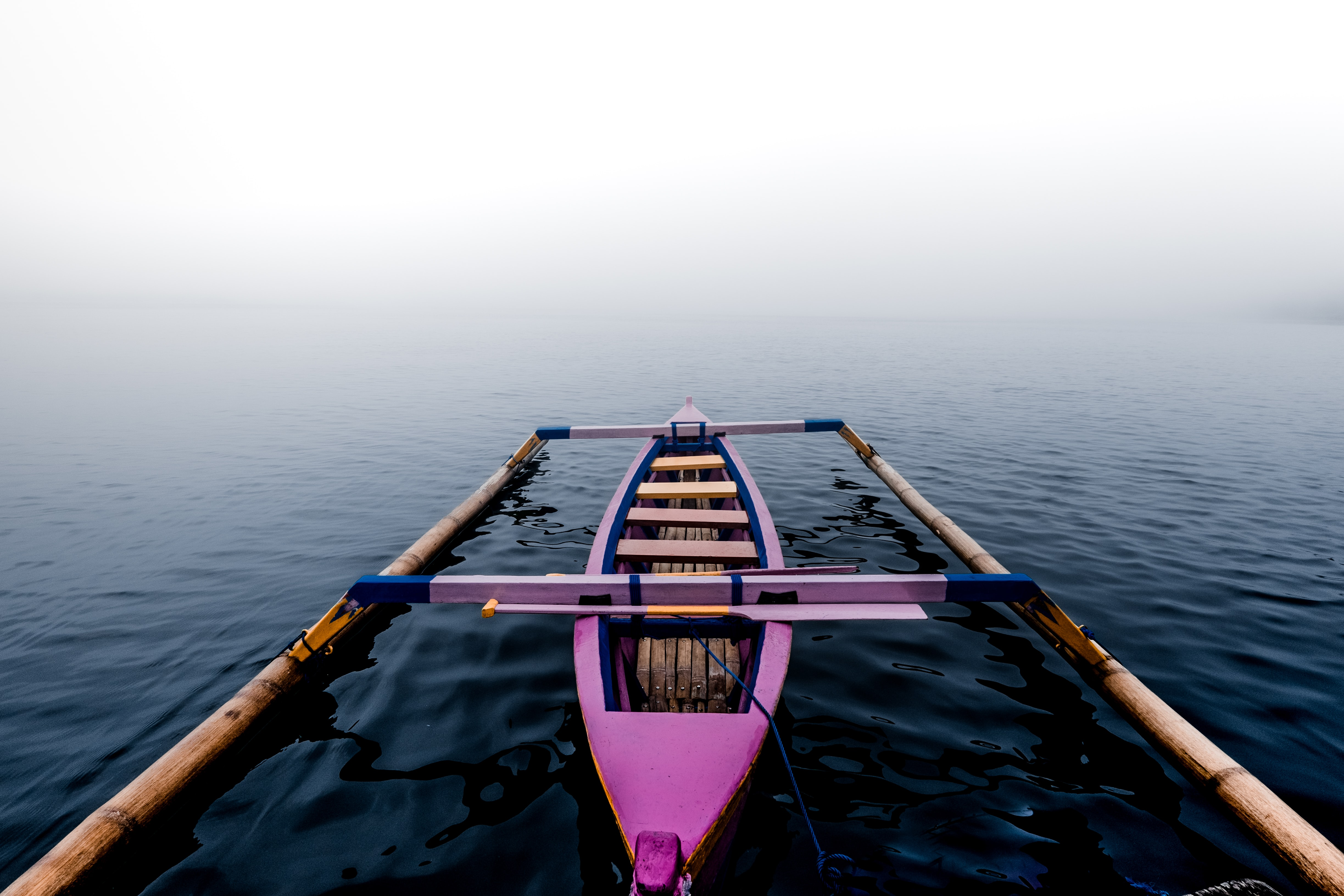 pink kayak on body of water