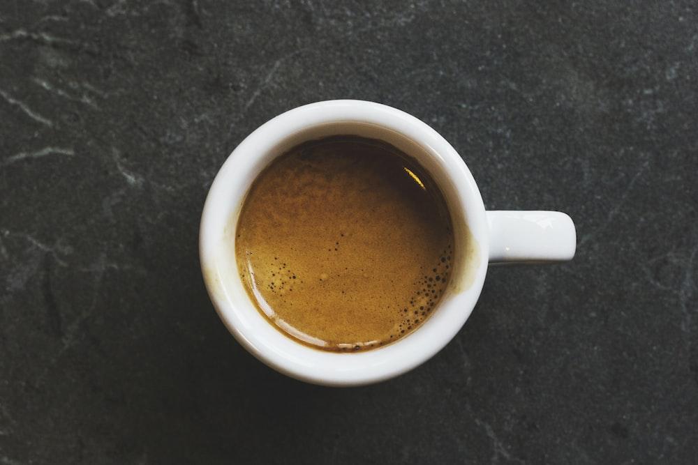 white ceramic mug fill with coffee
