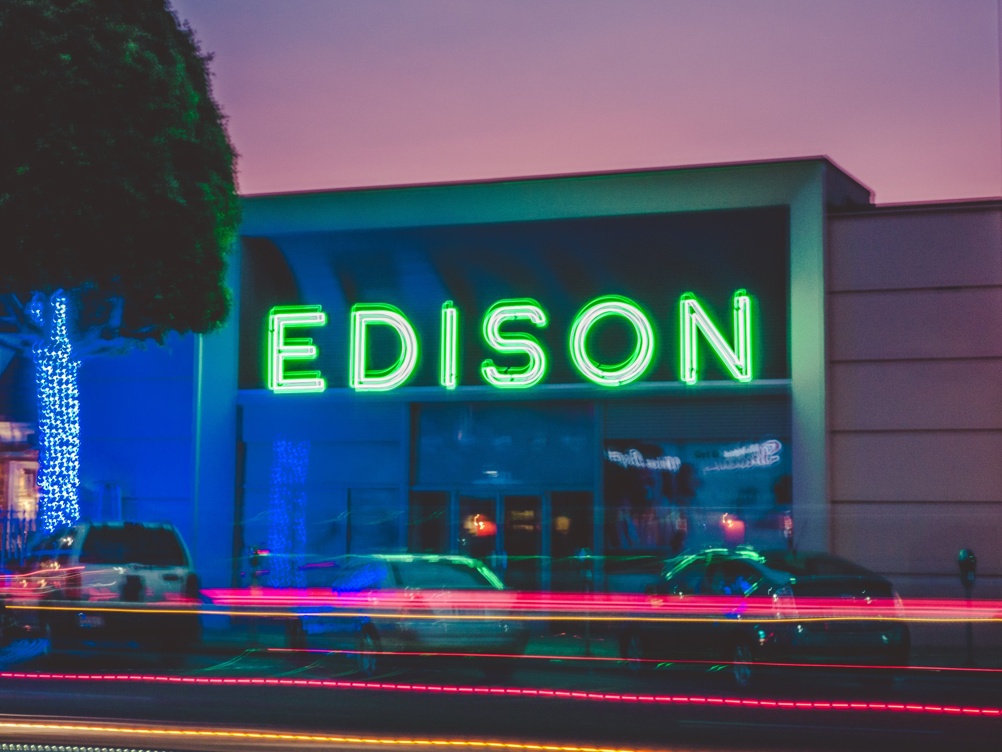 three vehicles parked in front of Edison building
