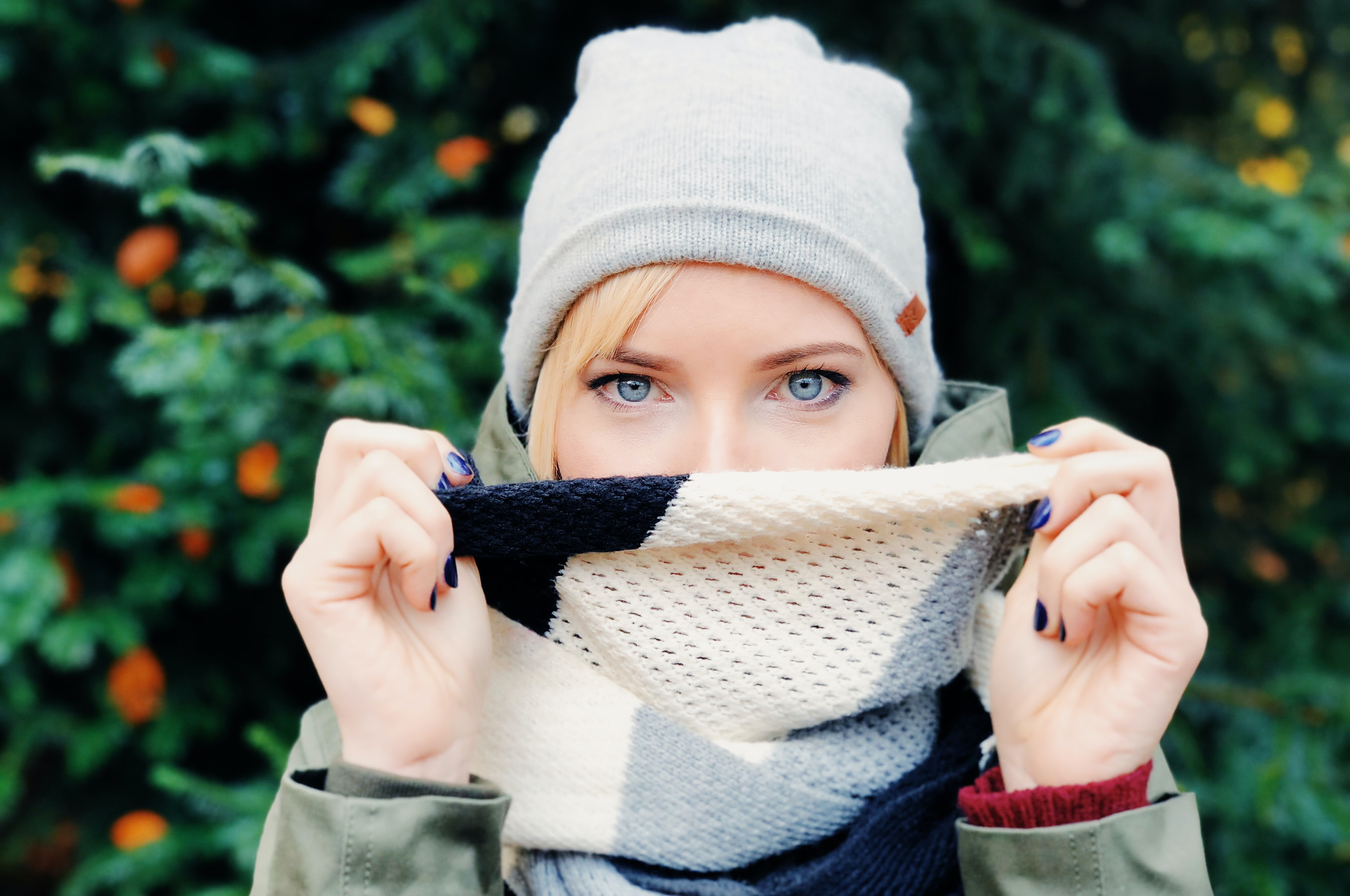 selective focus photography of woman covering half of her face
