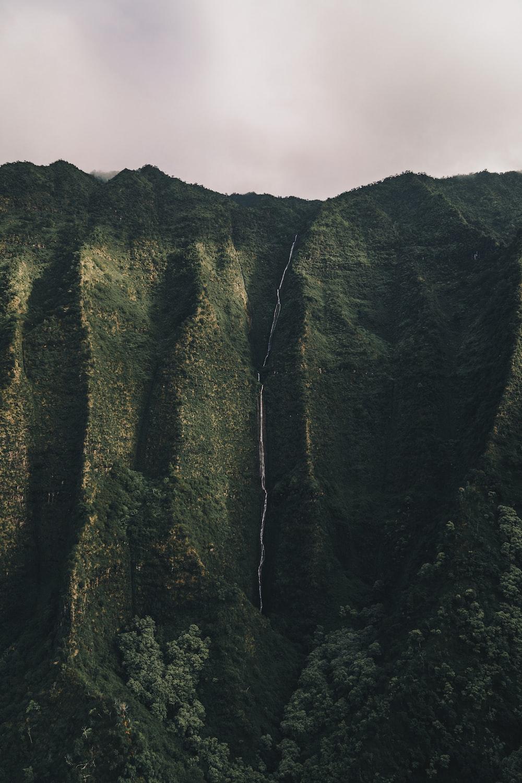mountain cliff under white sky