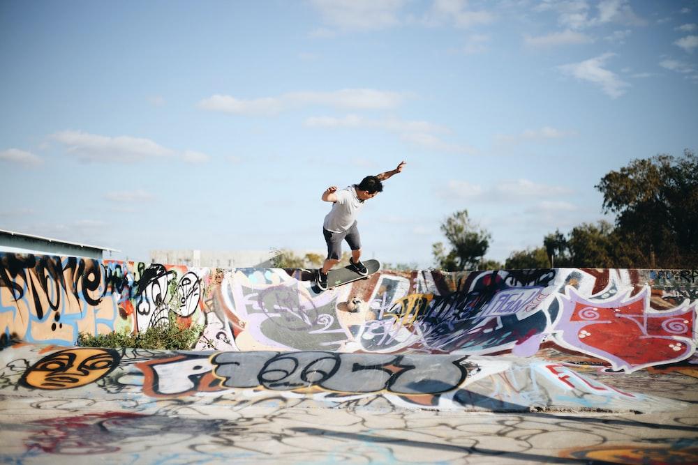 man riding skateboard doing stunt during daytime