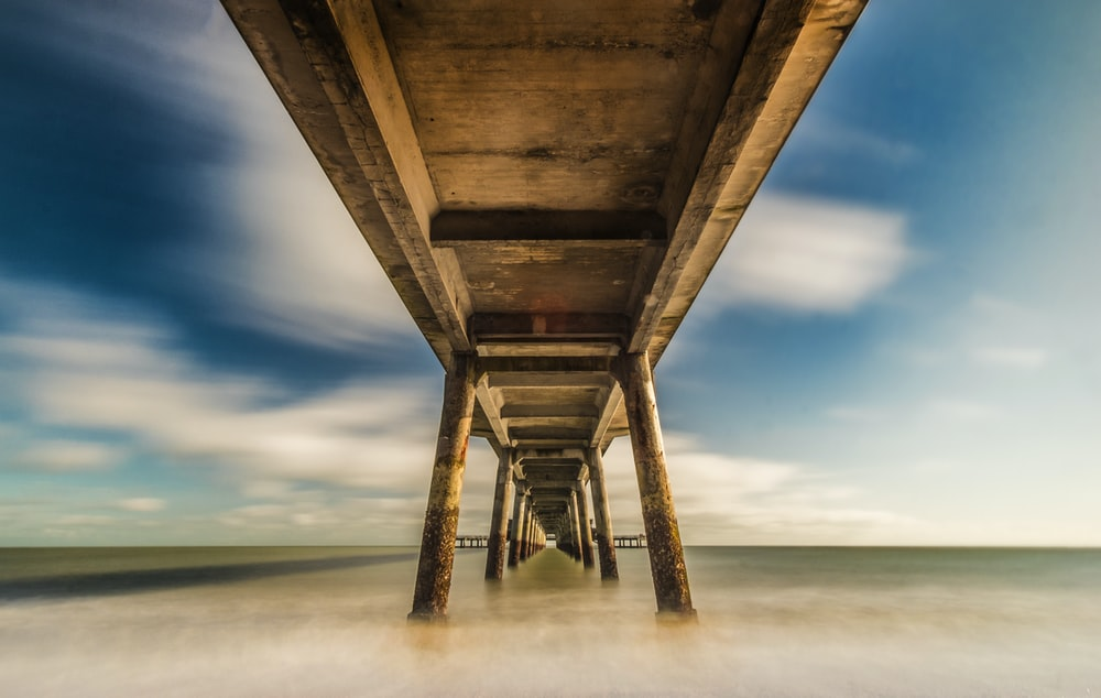 brown wooden dock above body of water in timelapse photography