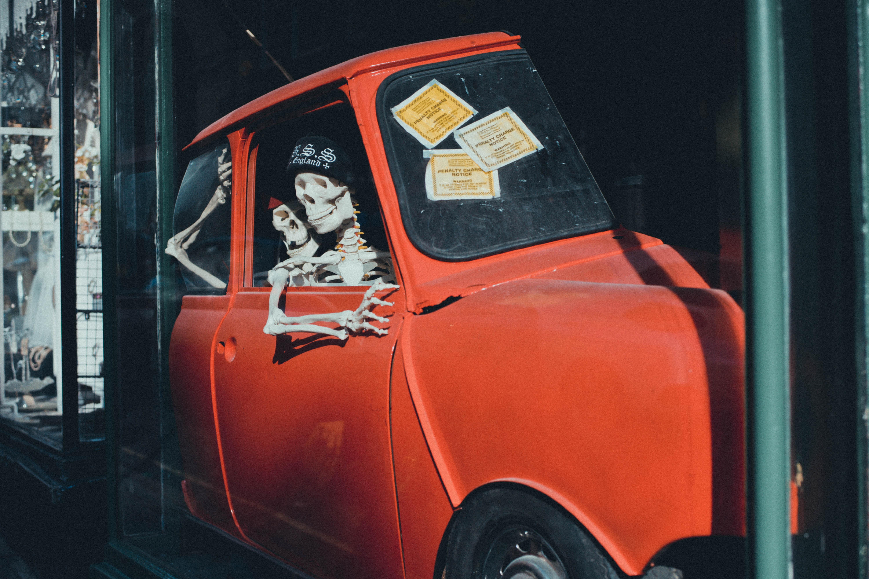 orange vehicle with skeletons