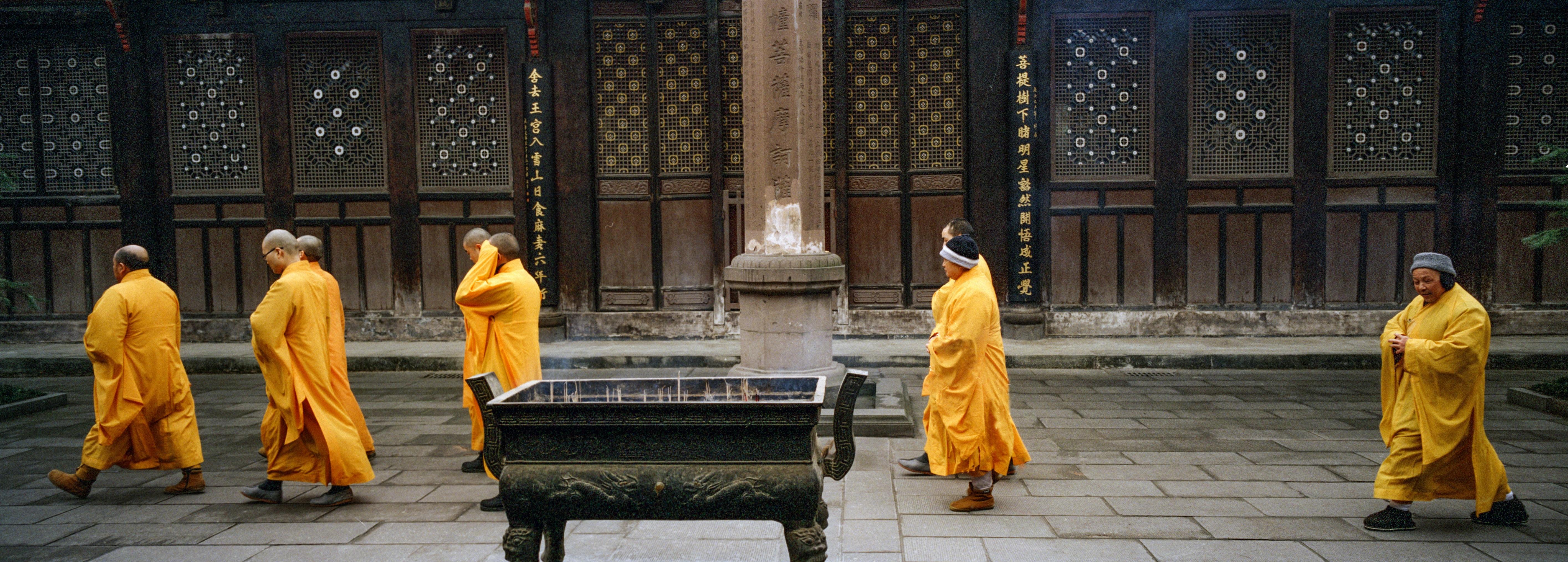 monk walking near temple