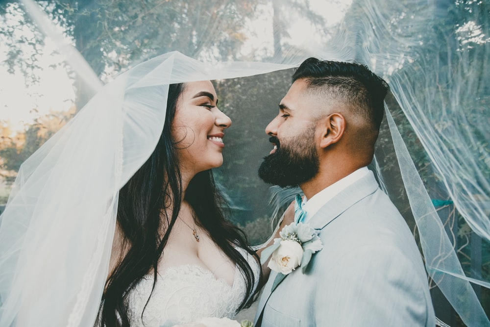 man and woman in wedding during daytime
