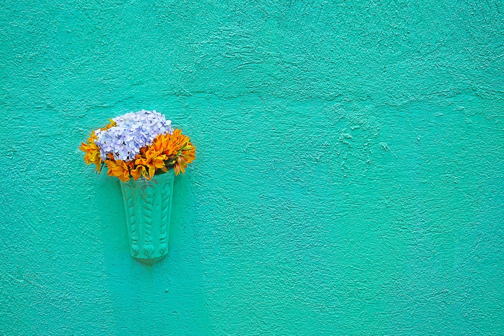 wall mounted white and orange flowers decoration