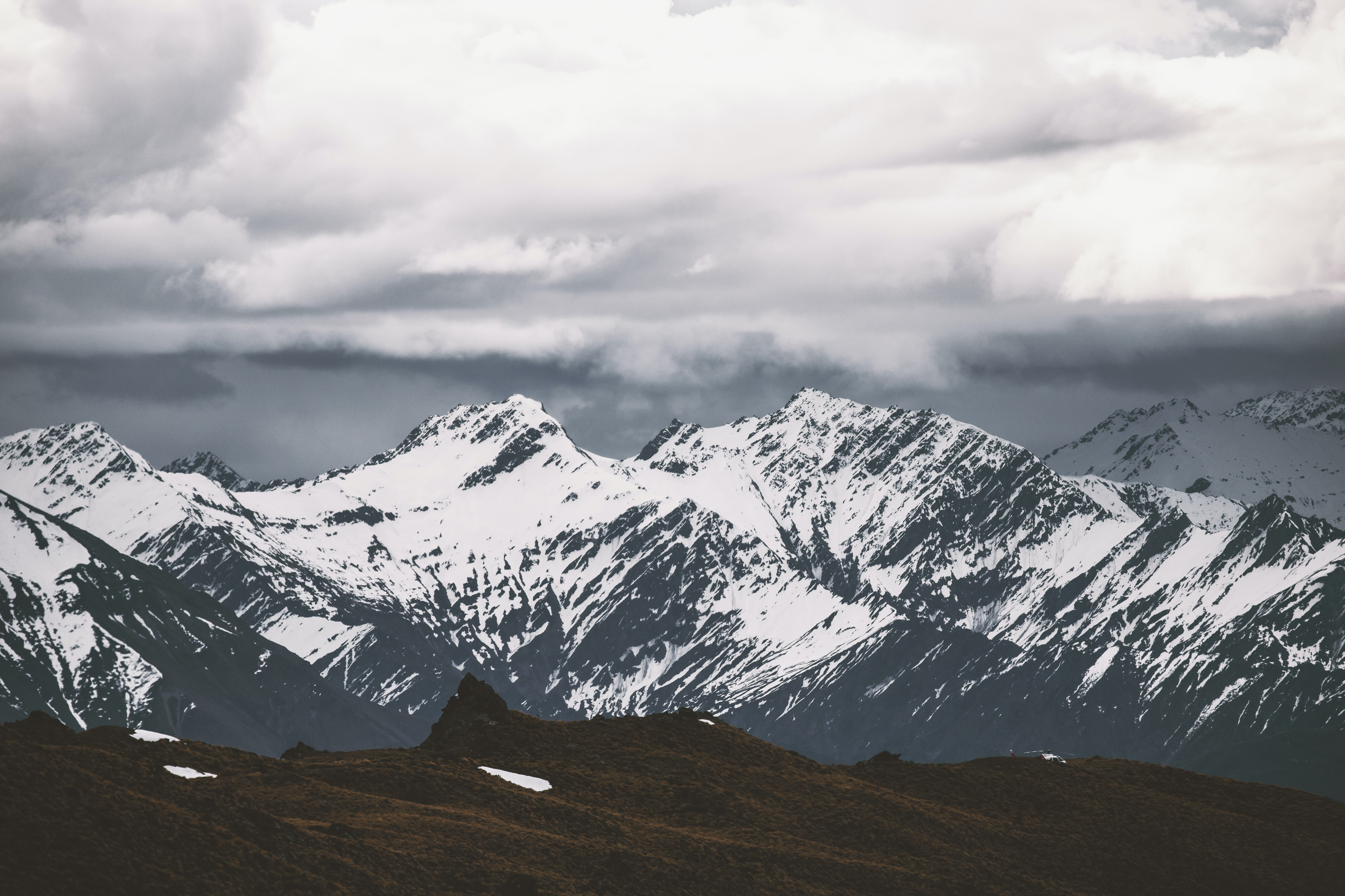 selective focus photography of mountain covered by snow