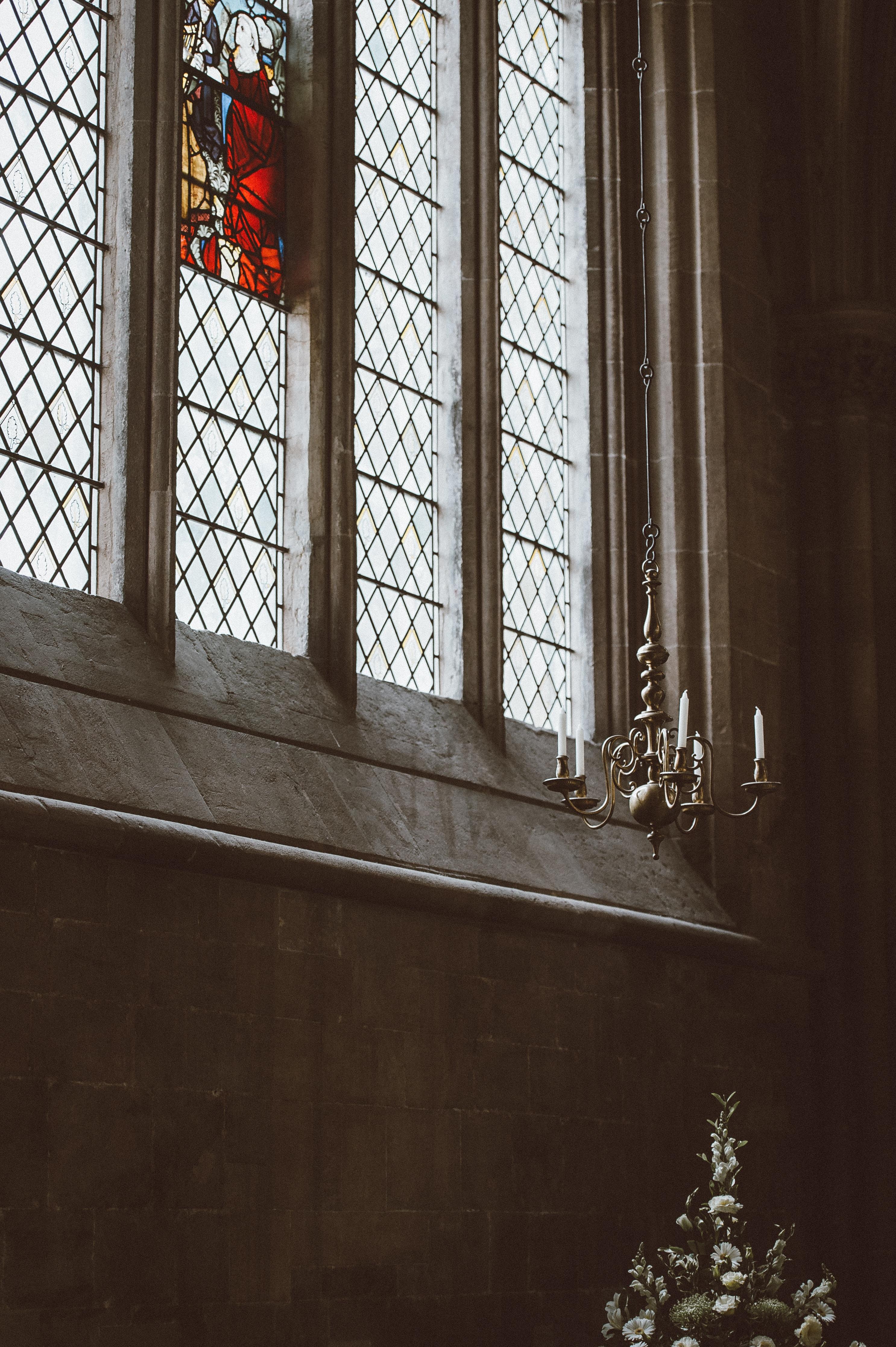gray uplight chandelier beside window