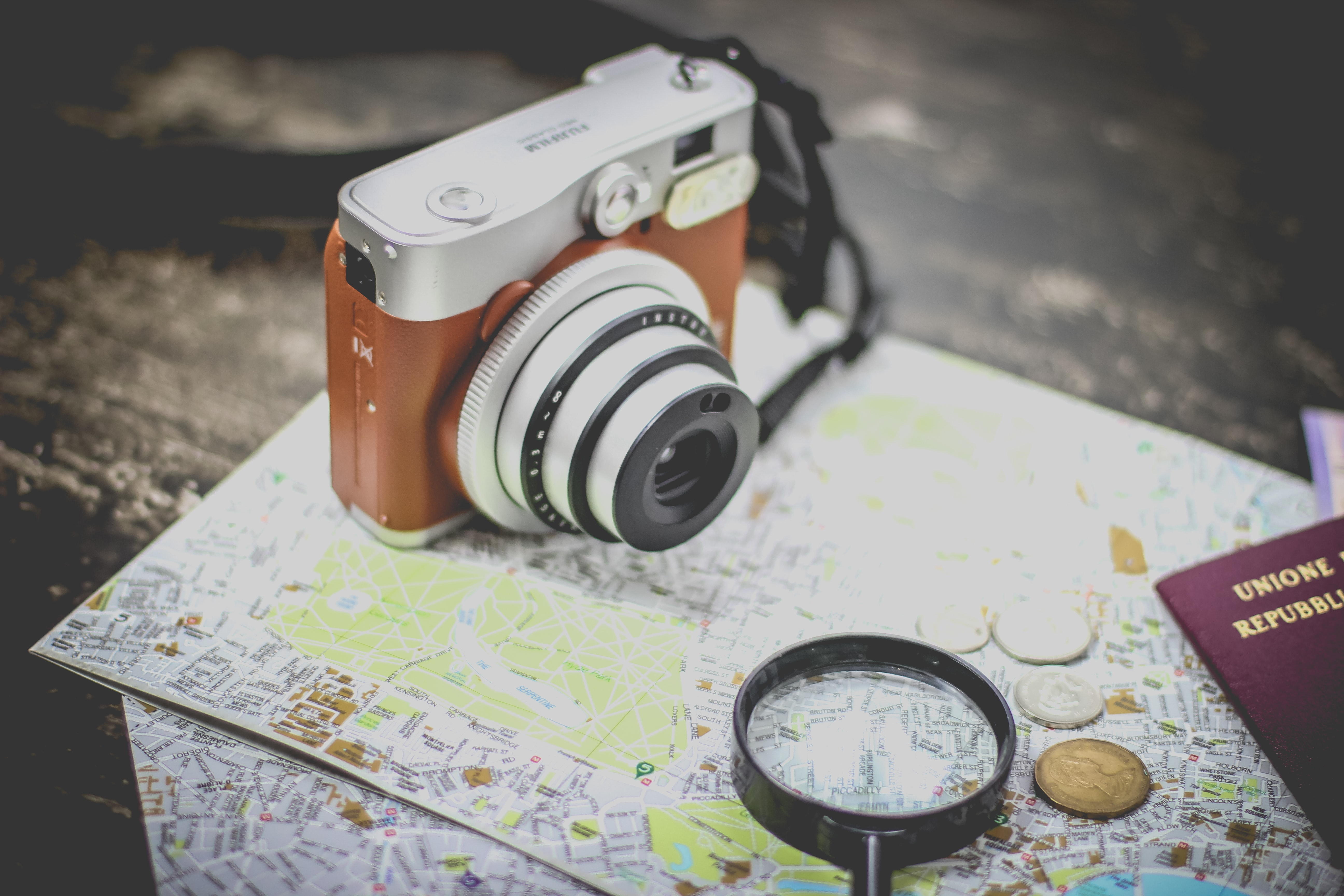silver point-and-shoot camera on geographical map